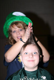Stylist Kim Childers has a little fun during the 2011 St. Baldrick&#039;s before shaving the head of Sammi Jo Potter, who is a four-time shavee. The event is a fundraiser for children&#039;s cancer research.