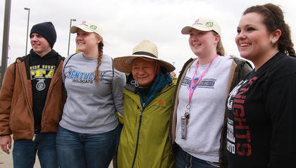 Marion County FFA students Anthony Mattingly, Bethany Purdom, Michelle Thompson, and Samantha Garrett pose for a photo with Professor Akira Miyawaki of Yokohama National University. Miyawaki has coordinated tree-planting events at Toyoda Gosei plants around the world. Toyoda Gosei is TG Kentucky's parent company.