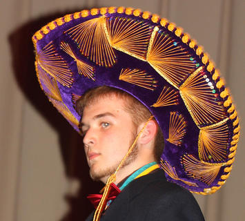 Matthew Newcome sported some stylish head ware during the poise portion of the competition.