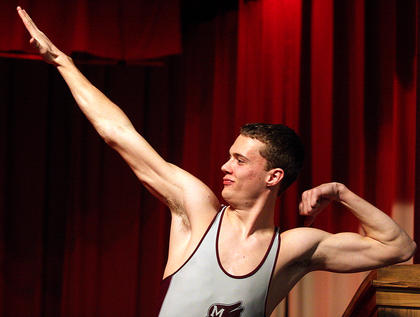 Brooks Divine strikes a pose and shows off his guns during the poise competition.