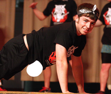 Nathan Shewmaker smiles while doing pushups during the physical fitness routine.