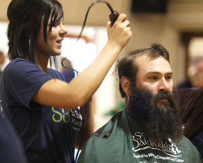 Stylist Mindy Garrett prepares to shave David Bell's head and beard. Bell is from Cox's Creek, and this was his second year participating in St. Baldrick's.