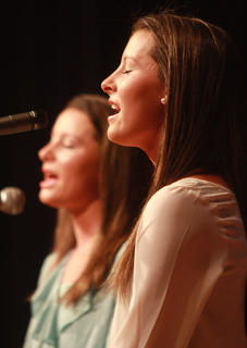 Samantha (foreground) and Katelyn Daugherty open the concert by harmonizing a few songs.