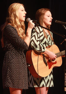 Sisters Sarah Jean and Elizabeth Hughes perform together.