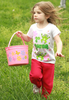 Mya Kehm, 4, of Lebanon runs through the grass to get to the next batch of eggs.