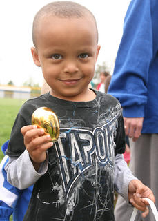 Rashaud Brown, 4, of Lebanon shows off the golden egg he found during the Easter egg hunt.