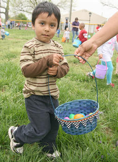 Max Castillo, 3, of Lebanon keeps moving with a little encouragement from his mother.