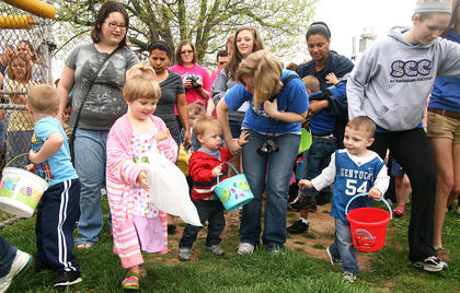 Children and their relatives burst through the gates at the start of the Easter egg hunt.