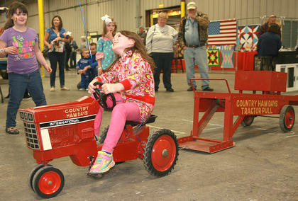 Rowan Cecil, 5, tries to push a little further in the pedal pull contest.