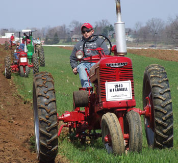 J. D. Harris, 15, drives a 1940 Farmall H. He was the youngest driver at this year's event.