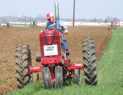 Jimmy Hughes helped get the field ready for this year's Plow Day, so it's only fair for a that he took a ride on his 1942 Farmall M.