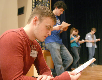 "Trevor Fitzpatrick and his classmates review the script for a scene from a modernized version of ""Romeo and Juliet."""