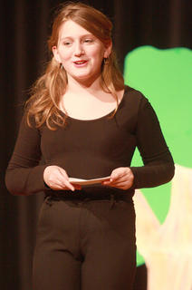 Emma Humphress introduces a skit during a performance for family members at the conclusion of the camp Friday afternoon.