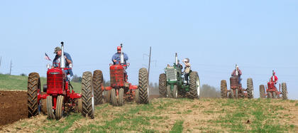 A row of tractors plow through the field at Goodin View Farms on Saturday.