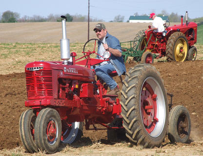 Elmer Hughes takes a Farmall H for a few trips around the field.