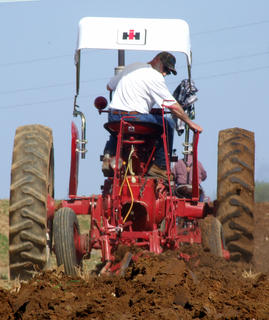 Jeff Hamilton checks his plow during a pass through the field.