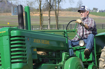 Jackie Crouch enjoys a trip on his John Deere A.