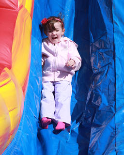 Sadie Davis, 4, of Lebanon was all smiles going down the inflatable slide.