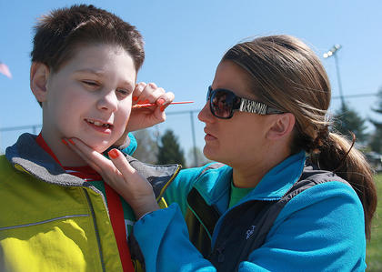 Davette Mayes, right, does a bit of face-painting for Seth Conover, 8, of Springfield.