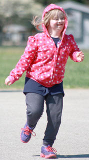 Madison Barlow of Lebanon Elementary can&#039;t stop smiling as she runs her leg in a race.