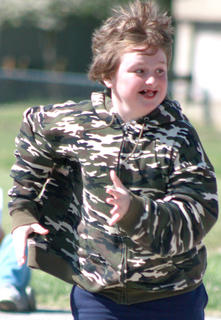 Ryan Shuck of Glasscock Elementary sprints to the next station in relay race combining running and cup stacking.