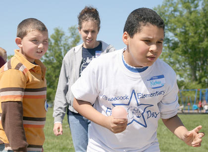 Nathan Hunt of Glasscock Elementary was ready to got at the start of the water balloon relay. James Curtsinger of West Marion Elementary, left, was one of Hunt's teammates in the race. Jill Gaddie offered encouragement to the entire team.