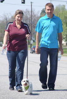 Erica and Tracy Barnes walk their shih tzu, Boots, during Strut Your Mutt.