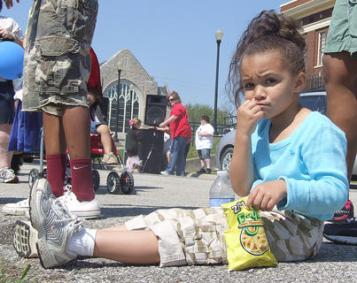 Jayla Luckett, 5, takes a break after finishing the walk.