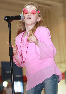 "Third-grader Gracie Bradshaw does her best Janis Joplin impression during ""Piece of My Heart."""