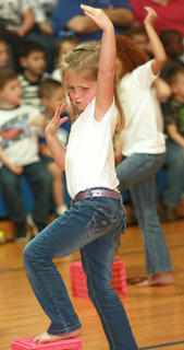 "Kindergartener Miranda Buckler does some enthusiastic air guitaring to the Lemonheads' remake of ""Mrs. Robinson."""