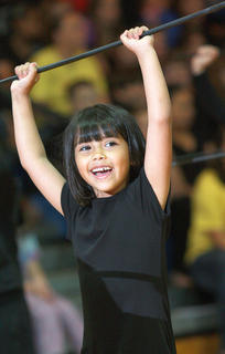 Kindergartener Lea O&#039;Daniel shows off her moves to &quot;Kung Fu Fighting&quot;.