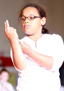 """Brae Washington and the other second graders perform to """"Hero"""" by Mariah Carey."""