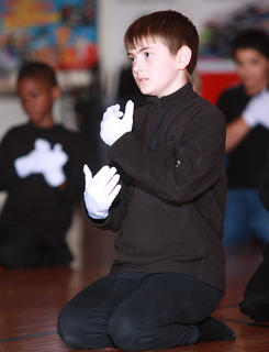 "Alex Tungate and the rest of the third graders perform to the song ""Hands"" by Jewell."