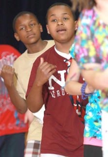 TaSean White, front, and  David Dupree wait for the chance to freestyle during the fifth grade routine.