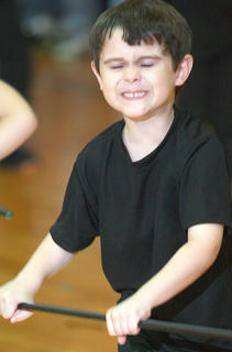 Kindergartener Aiden Phllips got into the spirit of the song, &quot;Kung Fu Fighting.&quot;