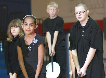 "Fourth graders Sarah Followell, Kristin Downs, Luke Inman and Adam Deering perform to ""Beautiful"" by Christina Aguilera."
