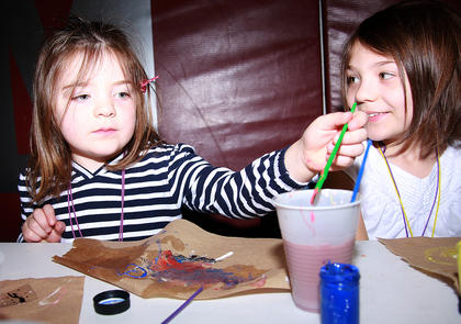 Maddie Hardin, 4, of Lebanon (left) paints alongside her sister, Riley, 9.