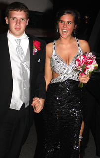 Amelia Mattingly flashes a big smile at the crowd as she and her date, Caleb Clark, make their grand entrance into the prom. They were later named prom king and queen.