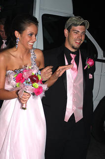 Tessa Simpson is pretty in pink while her date, Clay Smith, adds a touch of camouflage to his ensemble.