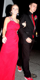 The lady in red, JoAnn Elder, and Austin Pittman, sporting the red sneakers, arrive to the prom in style.