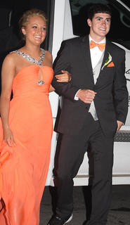 Michaela Butcher and John Southall show off their pearly whites as they arrive to the prom Saturday.