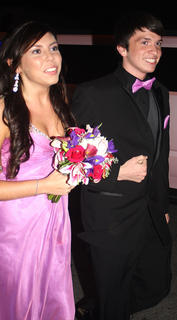 Jonathan Spalding flashes a big smile as he and his date, Paige Raikes, make their grand entrance.