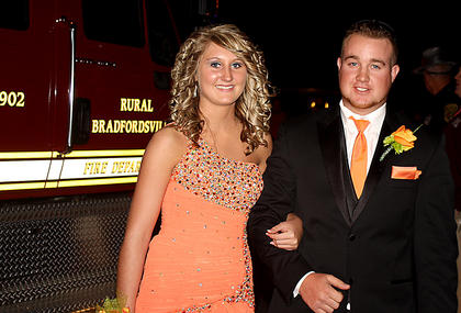 Chris Rakes and his date arrive to prom on a Bradfordsville fire truck.