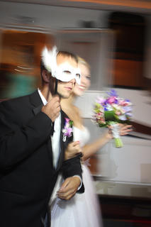 Jason Orberson wears a mask belonging to his date, Kaitlyn Spalding.