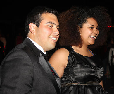 Alejandro Berlanga and Morgan Bell pose for a photo as they make their grand entrance into the prom.
