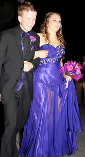 Blair Gorley smiles as he escorts Caroline Browning into prom.