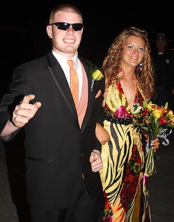 Levi Mattingly is so cool he has to wear shades as he escorts his date, Rebekah Taylor, into prom.