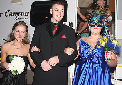 Justin Price has not one but two prom dates, Anne Claire Thomas, left, and Laura Buckman.