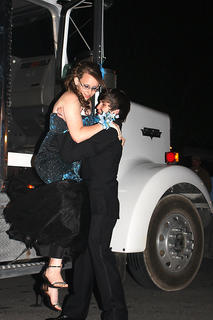 T.J. Colvin helps his date, Rachael Smith, get out of a semi-truck, which was their chosen means of transportation for the prom.
