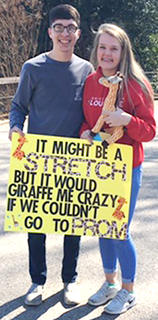 Trey Spalding asked Hannah Shoemake to prom at the Louisville Zoo.